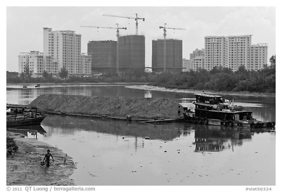 River scene and high rise towers in construction, Phu My Hung, district 7. Ho Chi Minh City, Vietnam (black and white)