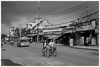 Street with moonson clouds, district 7. Ho Chi Minh City, Vietnam (black and white)