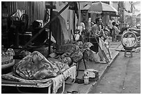 Vendors sleeping on the street at dawn. Ho Chi Minh City, Vietnam ( black and white)