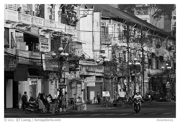 Facades of colonial-area townhouses. Ho Chi Minh City, Vietnam (black and white)