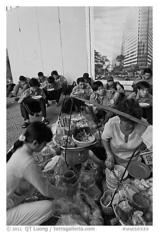 Food vendor preparing breakfast on the street. Ho Chi Minh City, Vietnam (black and white)