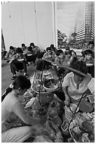 Food vendor preparing breakfast on the street. Ho Chi Minh City, Vietnam ( black and white)