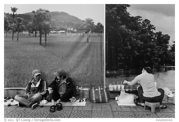 Students, food vendor, and landscape backdrops. Ho Chi Minh City, Vietnam (black and white)