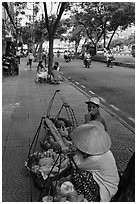 Women selling fruit on a large boulevard. Ho Chi Minh City, Vietnam ( black and white)