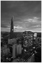 Bitexco Tower and city lights at sunset. Ho Chi Minh City, Vietnam ( black and white)