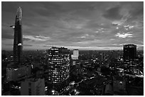 Bitexco Tower and city skyline at sunset. Ho Chi Minh City, Vietnam (black and white)