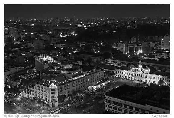 Peoples Committee building and Rex Hotel at night. Ho Chi Minh City, Vietnam (black and white)