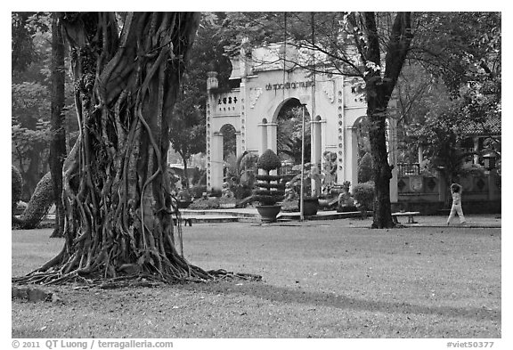 Tree, lawn, and gate, Van Hoa Park. Ho Chi Minh City, Vietnam (black and white)
