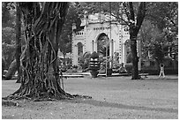 Tree, lawn, and gate, Cong Vien Van Hoa Park. Ho Chi Minh City, Vietnam (black and white)