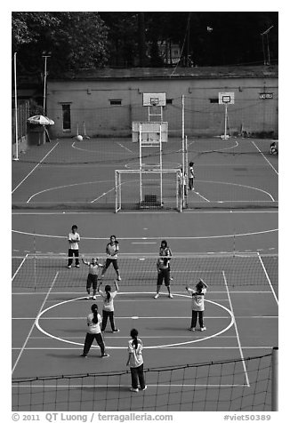 Girls Volleyball match, Cong Vien Van Hoa Park. Ho Chi Minh City, Vietnam (black and white)