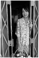 Teacher in doorway, Ho Chi Minh city. Vietnam ( black and white)
