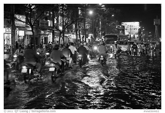 Flooded street and light reflections. Ho Chi Minh City, Vietnam (black and white)