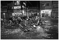 Street flooded by mooson rains at night. Ho Chi Minh City, Vietnam (black and white)