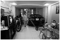 Living room used as car and motorbike garage. Ho Chi Minh City, Vietnam (black and white)