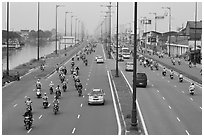 Busy expressway on banks of Saigon Arroyau. Cholon, Ho Chi Minh City, Vietnam ( black and white)