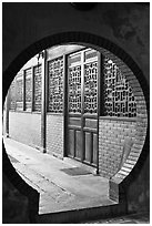 Circular door, Ha Chuong Hoi Quan Pagoda. Cholon, District 5, Ho Chi Minh City, Vietnam ( black and white)