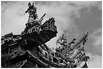 Ceramic figures on roof, Quan Am Pagoda. Cholon, District 5, Ho Chi Minh City, Vietnam (black and white)