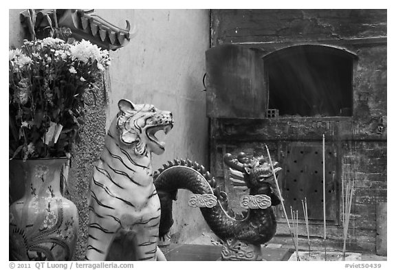 Ceramic tiger, dragon, and oven, Quan Am Pagoda. Cholon, District 5, Ho Chi Minh City, Vietnam (black and white)