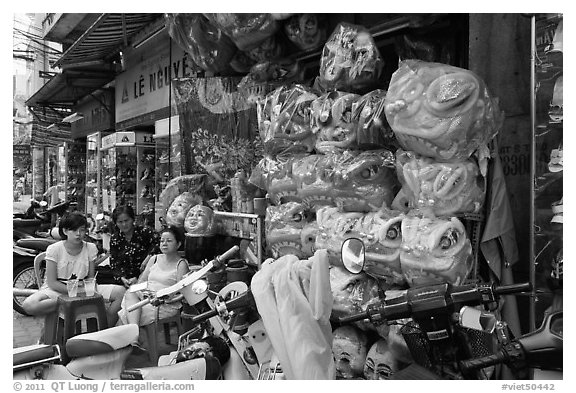 Shop selling dragon heads used for traditional dancing. Cholon, Ho Chi Minh City, Vietnam (black and white)