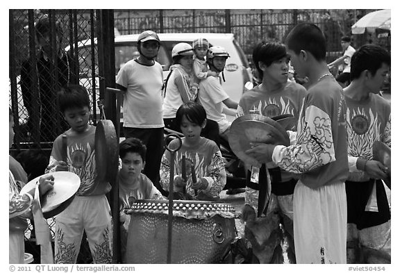 Dragon dance band made of children, Thien Hau Pagoda. Cholon, District 5, Ho Chi Minh City, Vietnam (black and white)