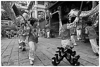 Dancers carry dragon on poles, Thien Hau Pagoda. Cholon, District 5, Ho Chi Minh City, Vietnam ( black and white)