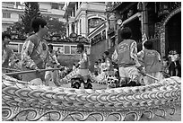 Dancers animating dragon, Thien Hau Pagoda, district 5. Cholon, District 5, Ho Chi Minh City, Vietnam ( black and white)