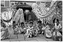 Dragon dancers at rest, Thien Hau Pagoda. Cholon, District 5, Ho Chi Minh City, Vietnam ( black and white)