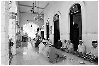 Men sharing food in gallery, Cholon Mosque. Cholon, District 5, Ho Chi Minh City, Vietnam ( black and white)