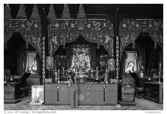 Woman at altar, Tam Son Hoi Quan Pagoda. Cholon, District 5, Ho Chi Minh City, Vietnam (black and white)