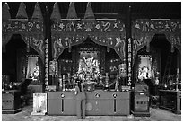 Woman at altar, Tam Son Hoi Quan Pagoda. Cholon, District 5, Ho Chi Minh City, Vietnam ( black and white)