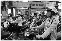 Commuters on motorcyles in stopped traffic. Ho Chi Minh City, Vietnam (black and white)