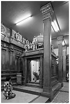 Worshipping inside Mariamman Hindu Temple. Ho Chi Minh City, Vietnam (black and white)