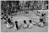 Uniformed schoolchildren, Cong Vien Van Hoa Park. Ho Chi Minh City, Vietnam ( black and white)