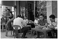 Men eating breakfast on the street. Ho Chi Minh City, Vietnam ( black and white)