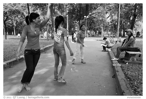 Young women practising dance, Cong Vien Van Hoa Park. Ho Chi Minh City, Vietnam (black and white)