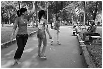 Young women practising dance, Cong Vien Van Hoa Park. Ho Chi Minh City, Vietnam ( black and white)
