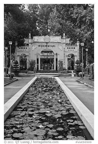 Lilly pond and temple gate, Van Hoa Park. Ho Chi Minh City, Vietnam (black and white)