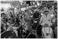 Street filled with motorcycles at rush hour. Ho Chi Minh City, Vietnam (black and white)