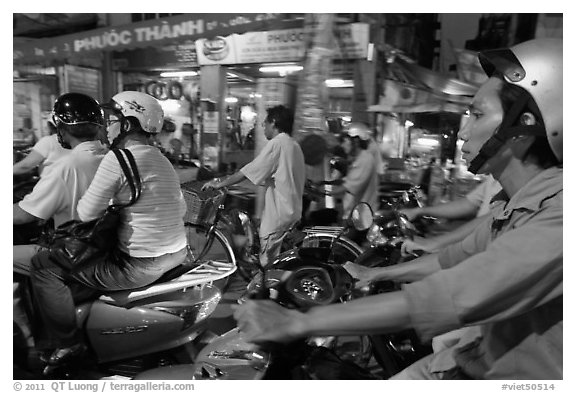 Motorcyle riders in traffic gridlock. Ho Chi Minh City, Vietnam (black and white)
