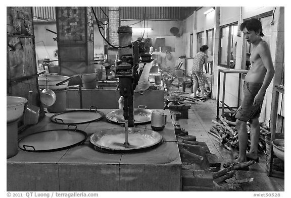 Pots in cococut candy factory. Ben Tre, Vietnam (black and white)