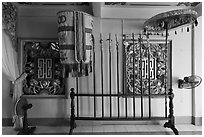 Rack with lamp, unbrella, lances, Saigon Caodai temple, district 5. Ho Chi Minh City, Vietnam ( black and white)
