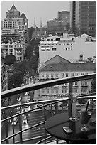 Drinks and view from rooftop bar of Hotel Caravelle. Ho Chi Minh City, Vietnam (black and white)