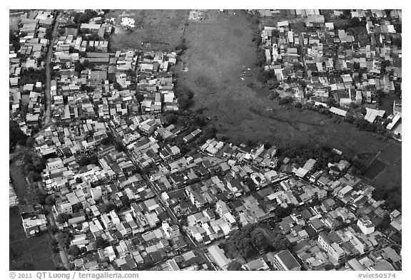 Aerial view of houses and fields on the outskirts of the city. Ho Chi Minh City, Vietnam (black and white)