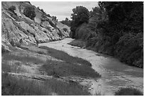 Fairy Stream passing through eroded sand and sandstone landscape. Mui Ne, Vietnam (black and white)