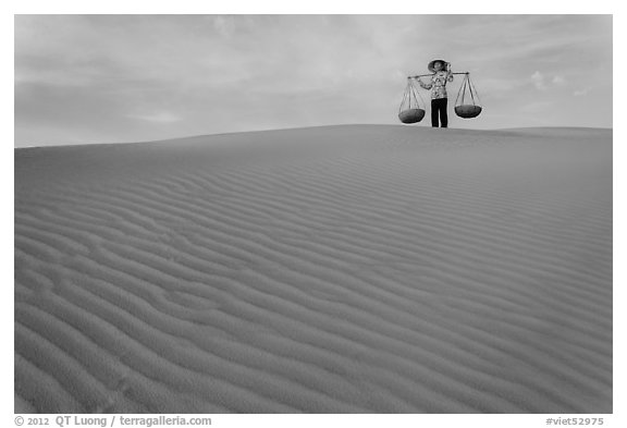 Woman on top of red sand dunes. Mui Ne, Vietnam (black and white)