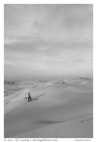 Sand dune landscape with figure. Mui Ne, Vietnam (black and white)