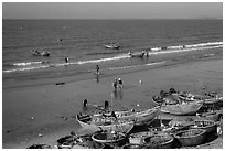 Boats and fishermen on beach. Mui Ne, Vietnam (black and white)