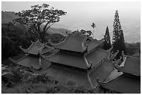 Temple rooftop overlooking plains in mist. Ta Cu Mountain, Vietnam ( black and white)