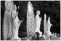 Three Buddhist statues. Ta Cu Mountain, Vietnam ( black and white)