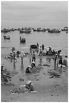 Fishing activity on beach near Lang Chai. Mui Ne, Vietnam (black and white)